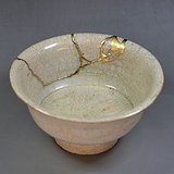 宋元时期白釉划花高足碗  金缮