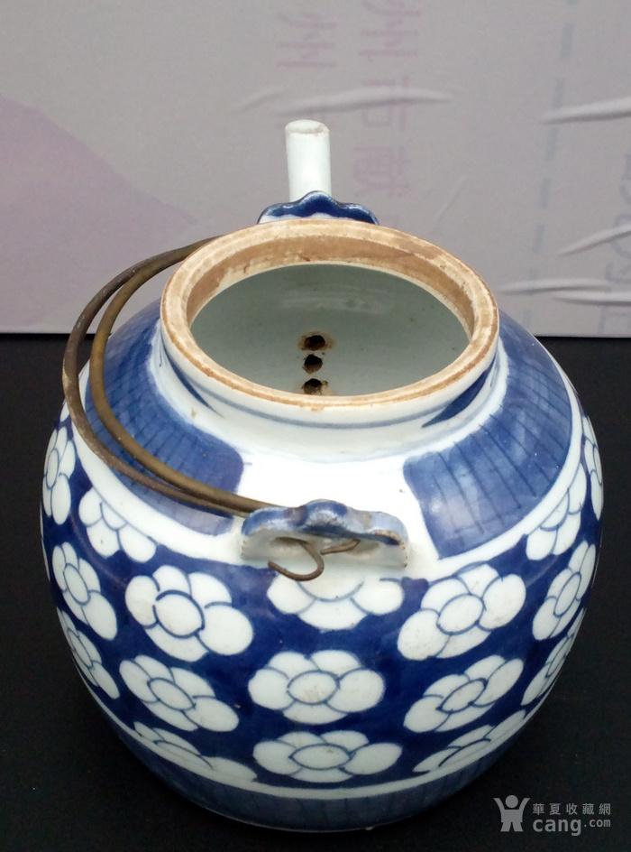 青花壶。图6