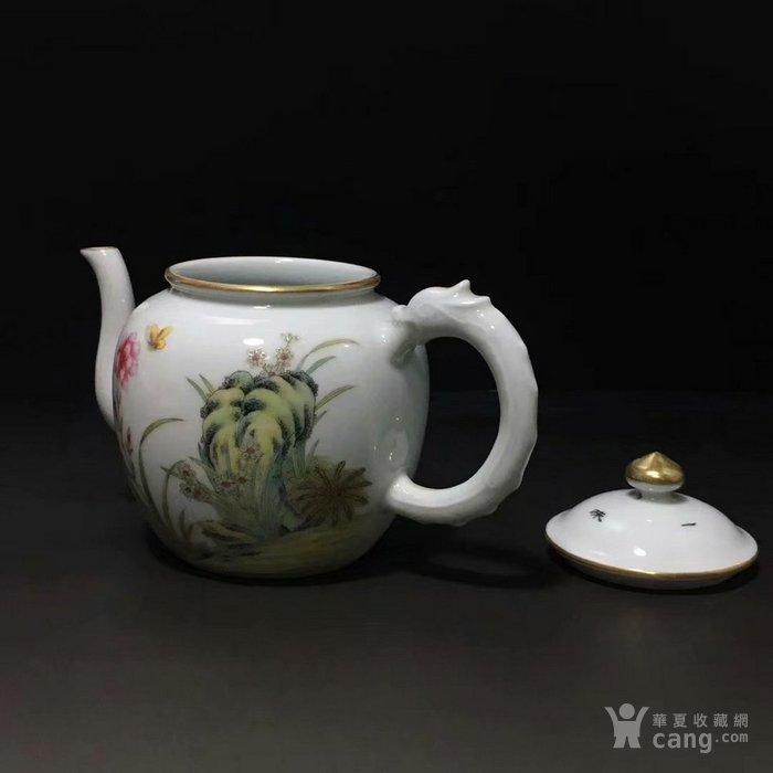 大清乾隆年制山石兰花龙柄茶壶图片