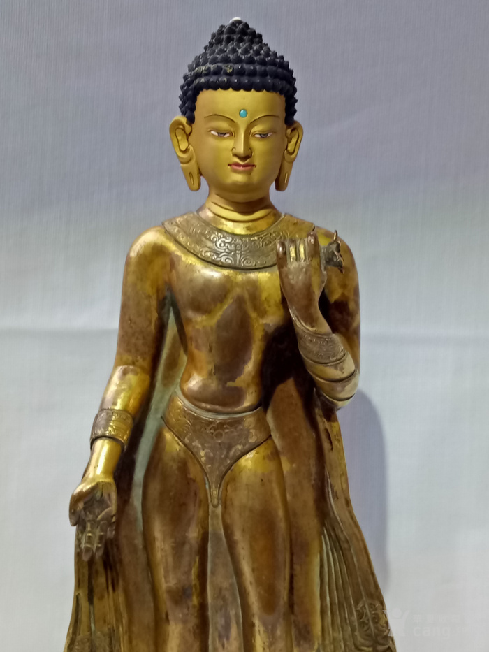 尼泊尔十三世紀红銅鎏金釋迦牟尼佛立像图7