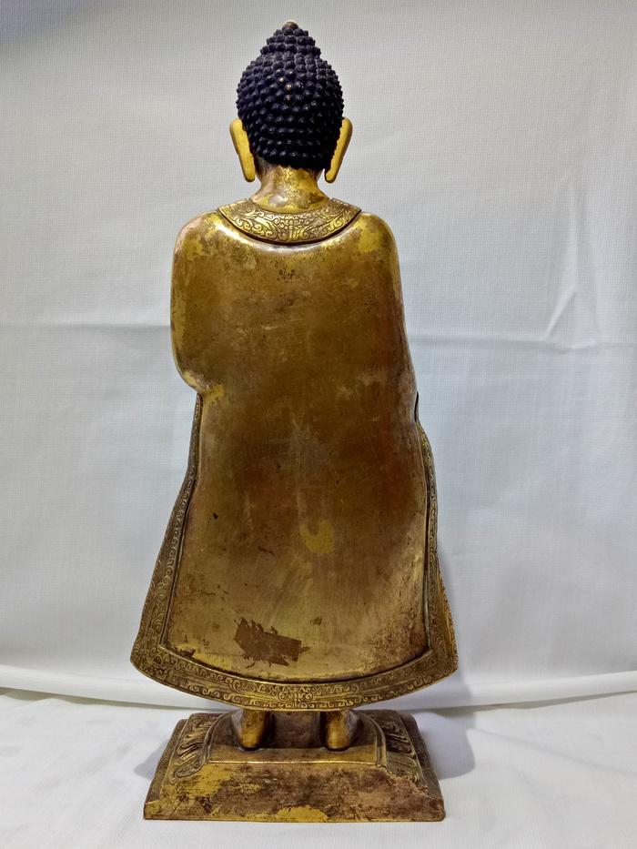尼泊尔十三世紀红銅鎏金釋迦牟尼佛立像图5