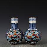 瓷胎掐丝珐琅彩蓝地花鸟天球瓶