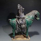 明. 黑绿釉武士骑马俑
