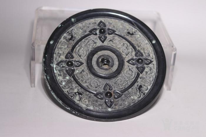 黑漆古花卉纹卷纹铜镜图1